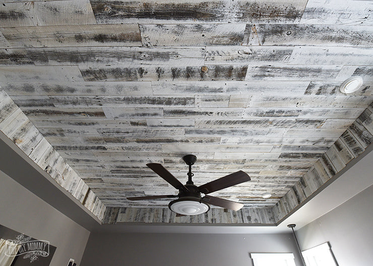 Wood planking for ceilings in weathered wood white blends well with a bronze ceiling fan.
