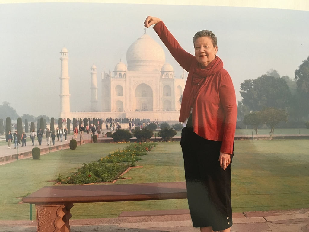 Best travel clothing ever. Woman in Movement Global Organic Bamboo clothing in front of Taj Mahal
