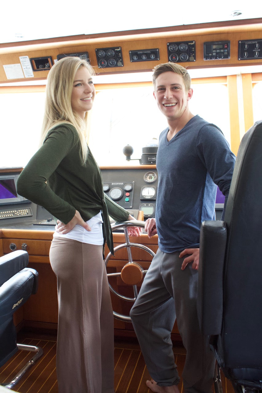 Two models wearing Movement Global sustainable west coast lifesytle clothing on a boat