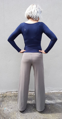 Girl wearing Belinda Ballet in Navy, with Carmen Long pants in Charcoal