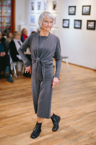 Modular, sustainable bamboo clothing in grey on an older model