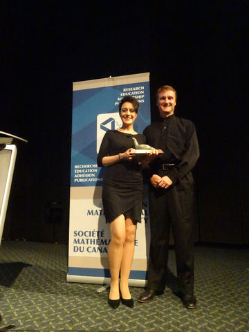 Stephanie accepting a prestigious math award in Movement Global sustainable organic cotton and bamboo dress