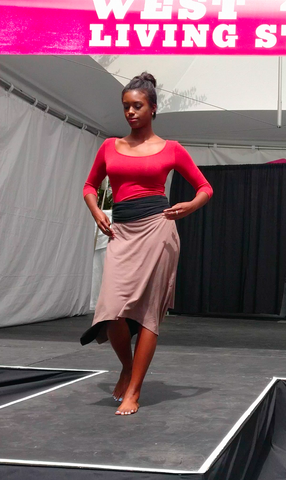 Movement Global sustainable fashion Beige and Black reversible skirt with red top on a black model