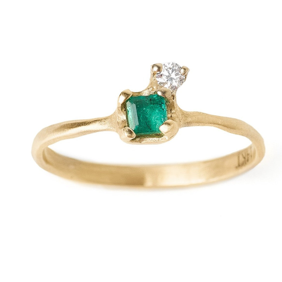 Emerald and diamond ring. Affordable alternative engagement ring set in 14kt yellow gold
