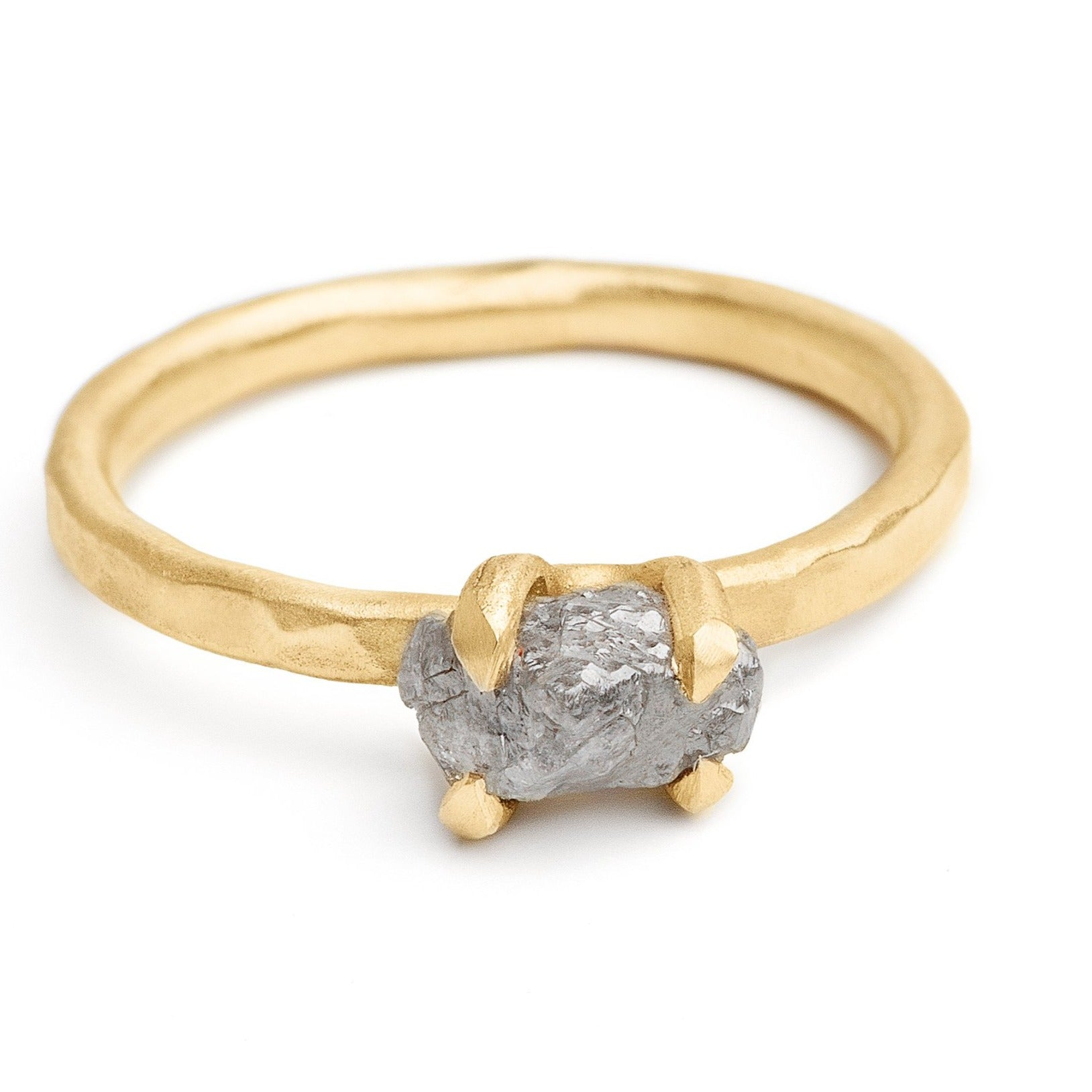 Rough grey diamond ring set in 14kt hammered yellow gold ring prong setting