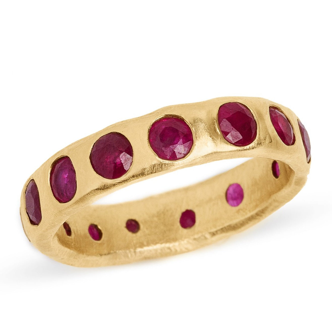 Ruby eternity band set in 14kt yellow gold wide ruby band.