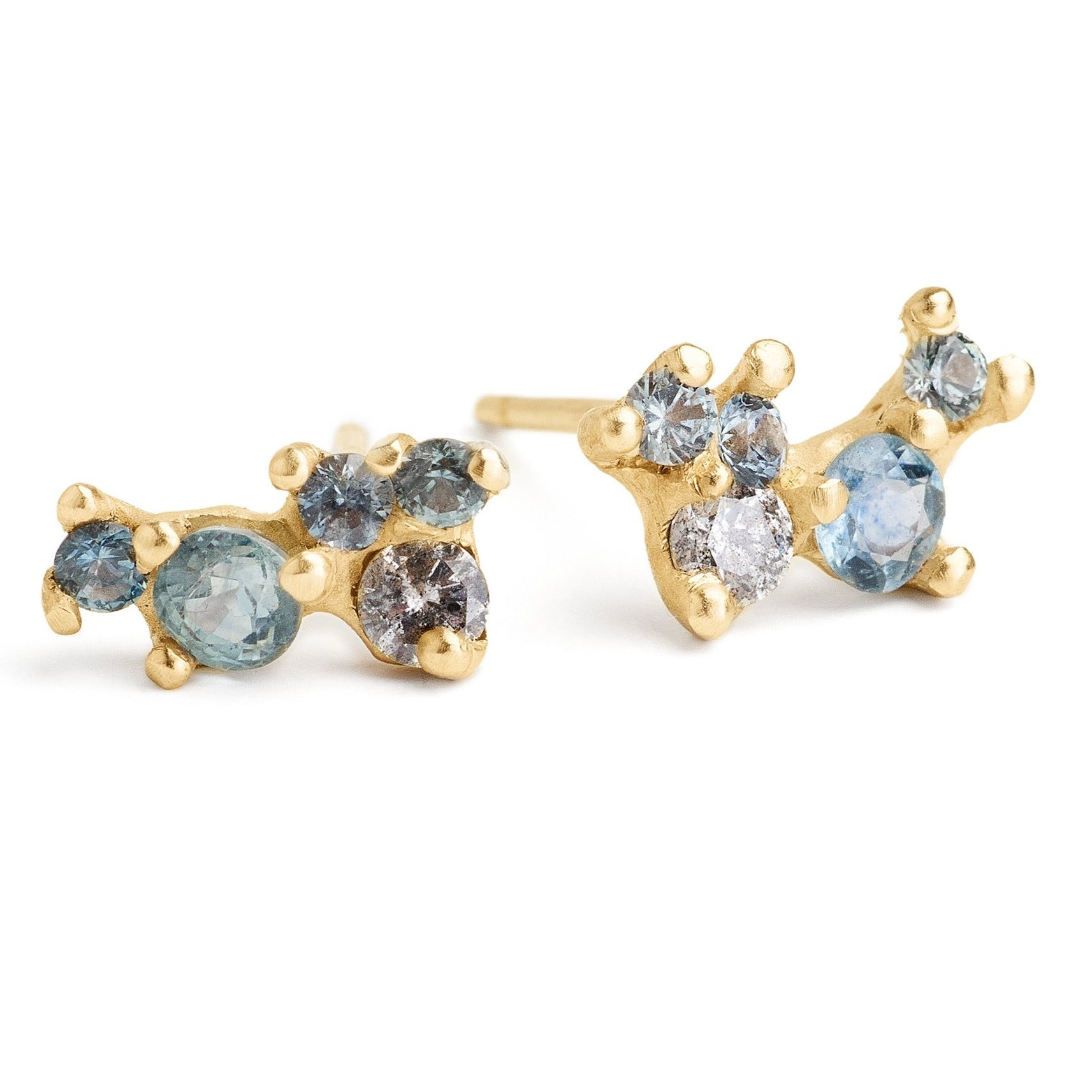 Gemstone cluster studs hand-made in Brooklyn. Montana Sapphires and grey diamond cluster stone earrings set in 14kt yellow gold