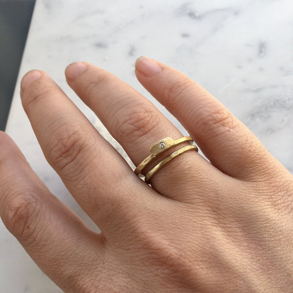 Hammered 14kt gold stacking ring with diamond. Simple rustic and unique engagment ring style