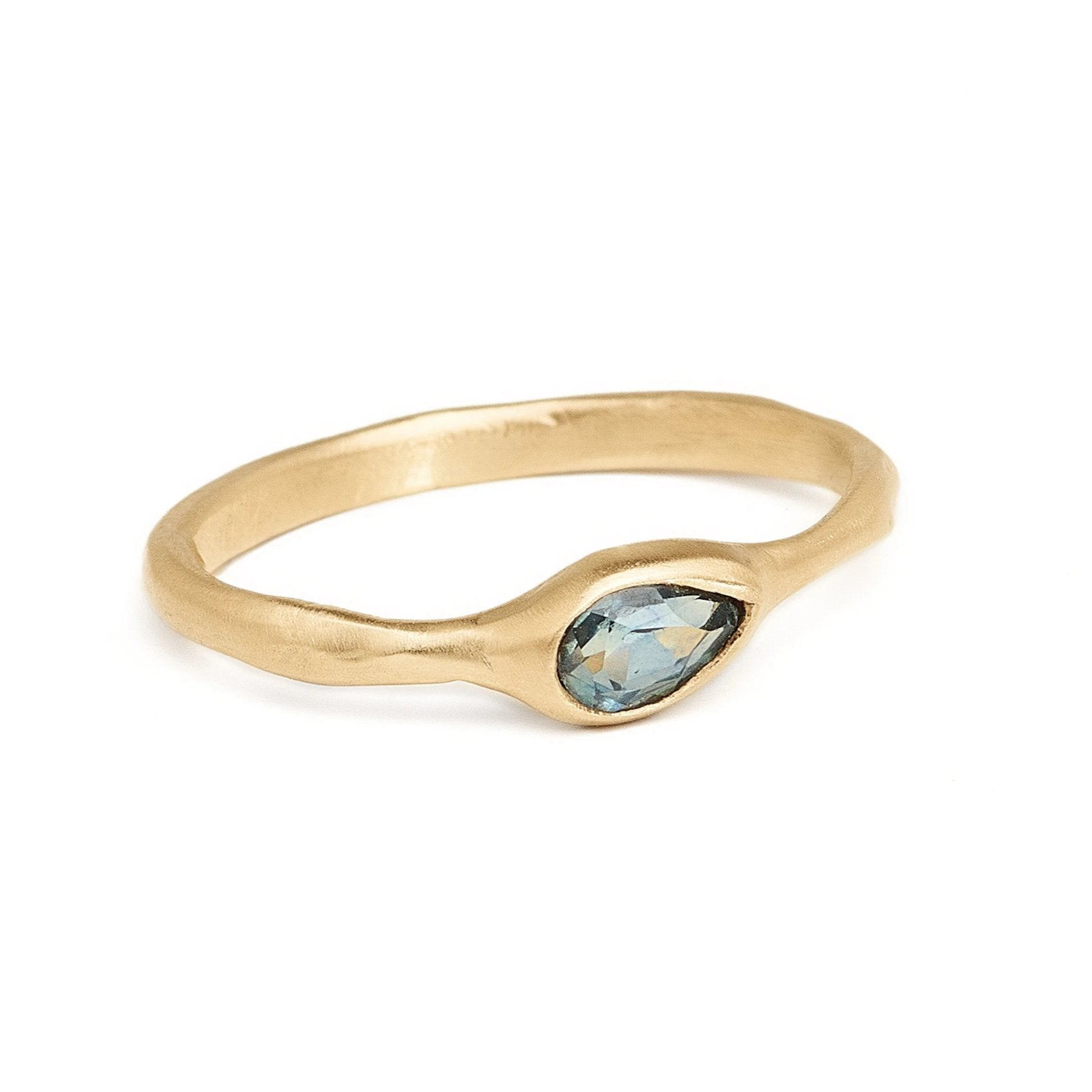 Pear shaped teal Montana sapphire delicate gold ring. Simple inexpensive alternative engagement ring.