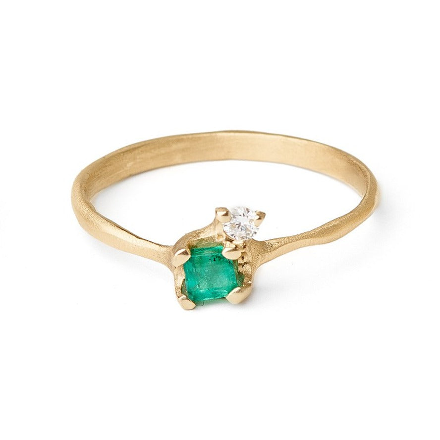 Pale emerald and diamond ring set in gold.  Ethically sourced emerald and diamond rings unique settings for emeralds. Alternative engagement rings