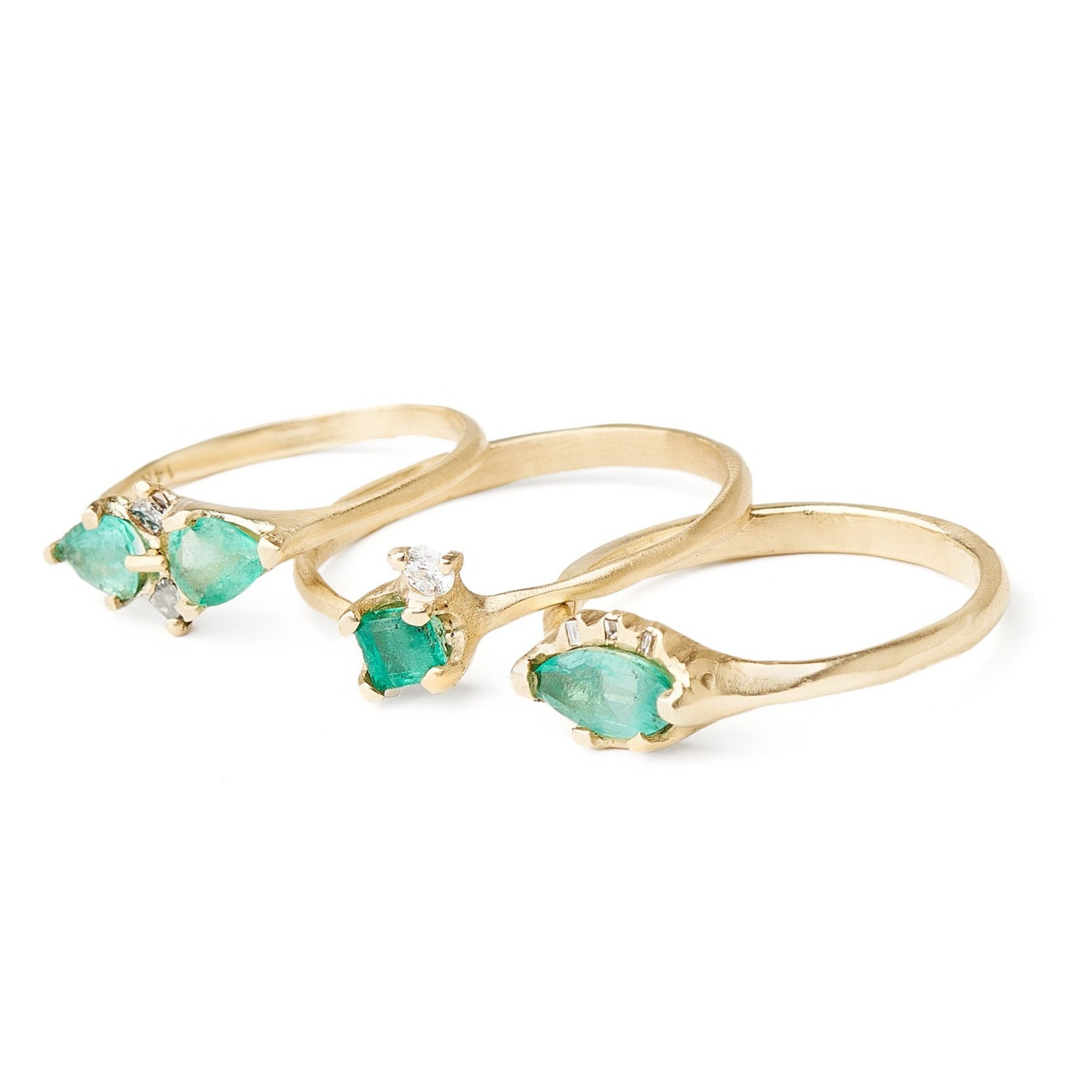 unique emerald rings with diamonds set in 14kt recycled yellow gold ethically sourced stones handmade with care.