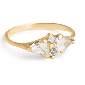 rose cut pear shaped white diamonds and princess cut grey diamond alternative diamond engagement ring set in 14kt yellow gold