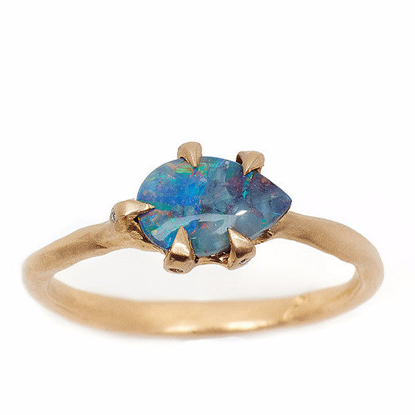 Blue pear shaped opal ring set in 14kt yellow gold with handmade setting