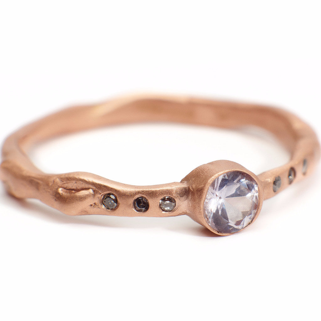 Blush sapphire and reclaimed grey diamond ring set in 14kt recycled rose gold. Handmade organic setting.  Sustainable and affordable engagment rings made in Brooklyn NY using recycled gold and reclaimed sustainable gemstones. Alternative bridal