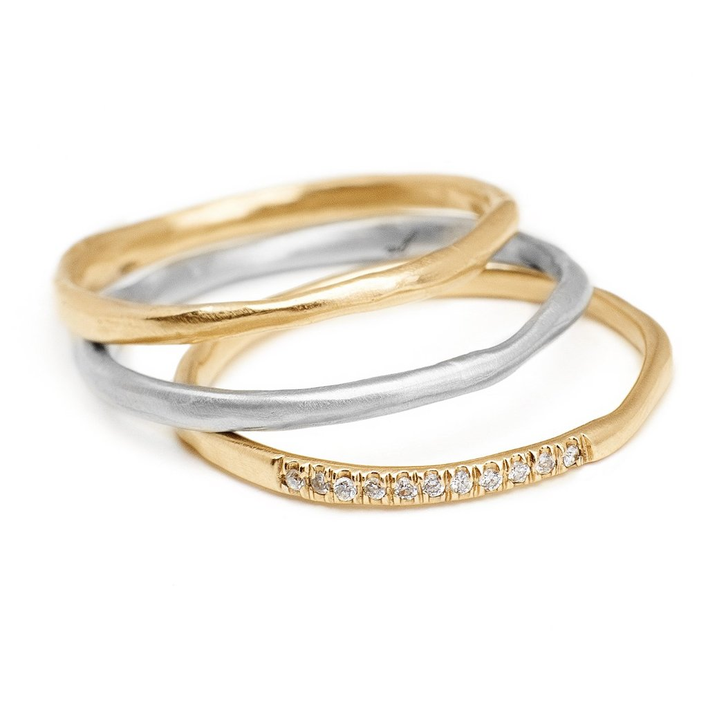 thin textured yellow and white gold stacking ring with pave diamonds