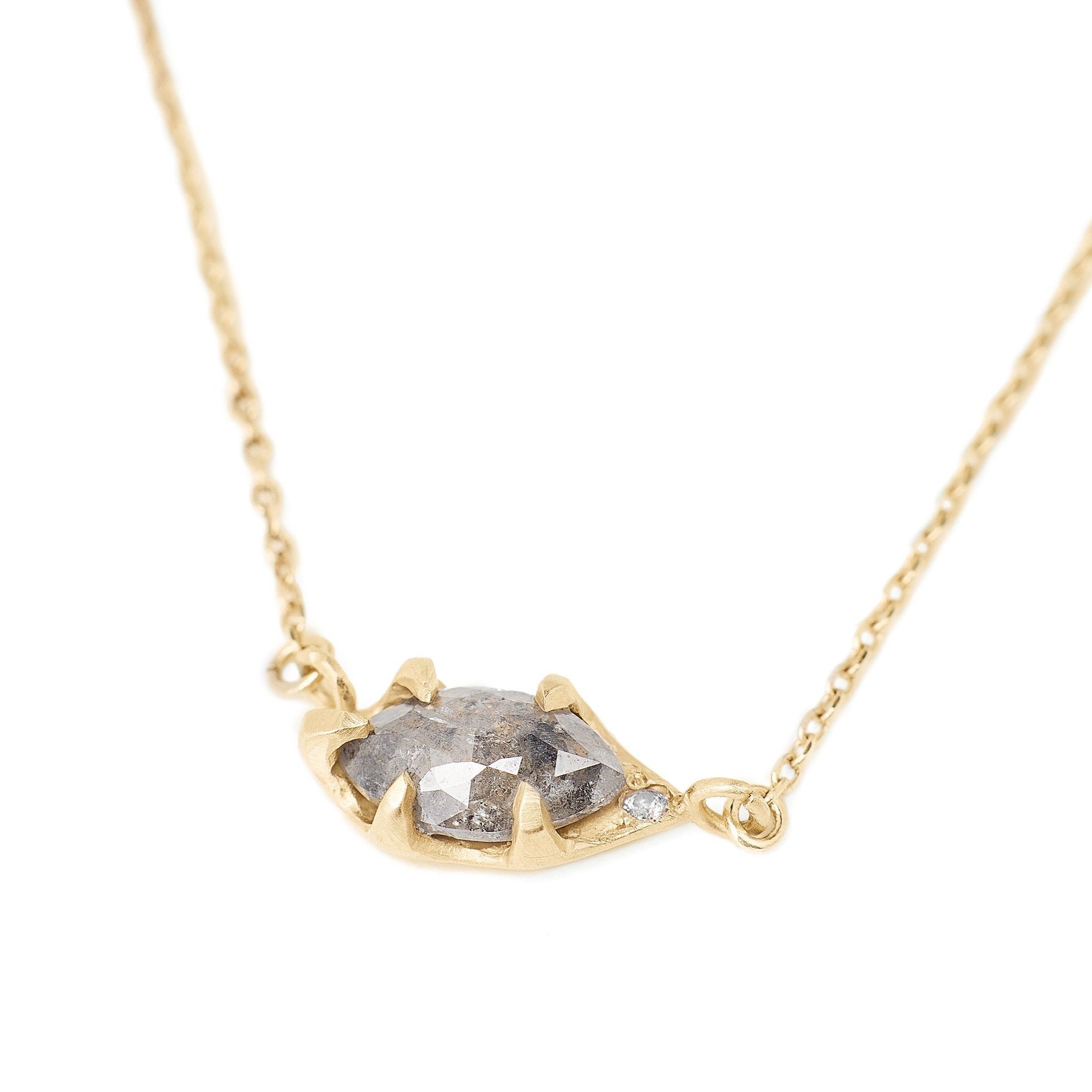 Salt and pepper rose cut diamond necklace set in 14kt gold. Diamond necklace incorporated into the delicate chain. Simple rose cut diamond necklace with a hidden pink diamond accent.
