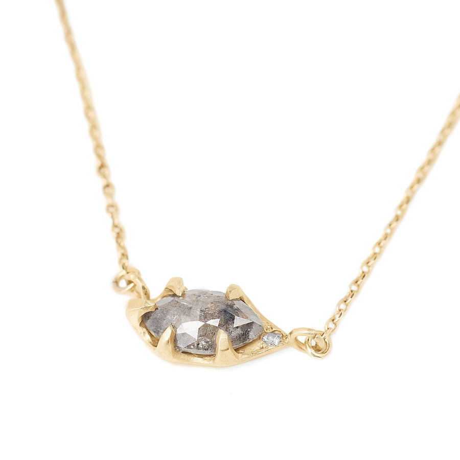Marquis salt and pepper rose cut diamond set in handmade 14kt gold setting with a pink diamond accent. Diamond necklace set horizontally on a delicate chain