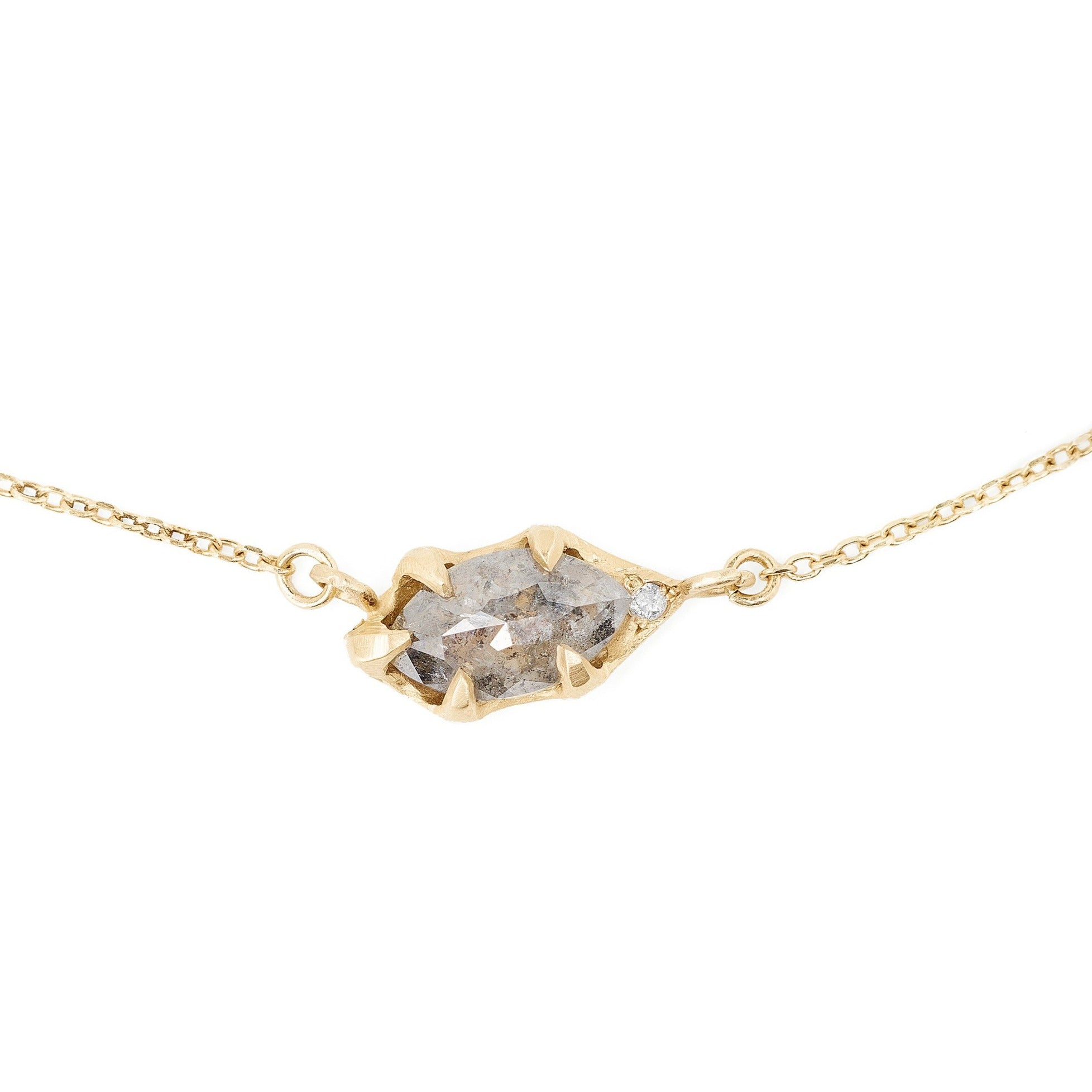 Salt and pepper rose cut diamond necklace set in 14kt gold delicate and simple with a hidden pink diamond accent