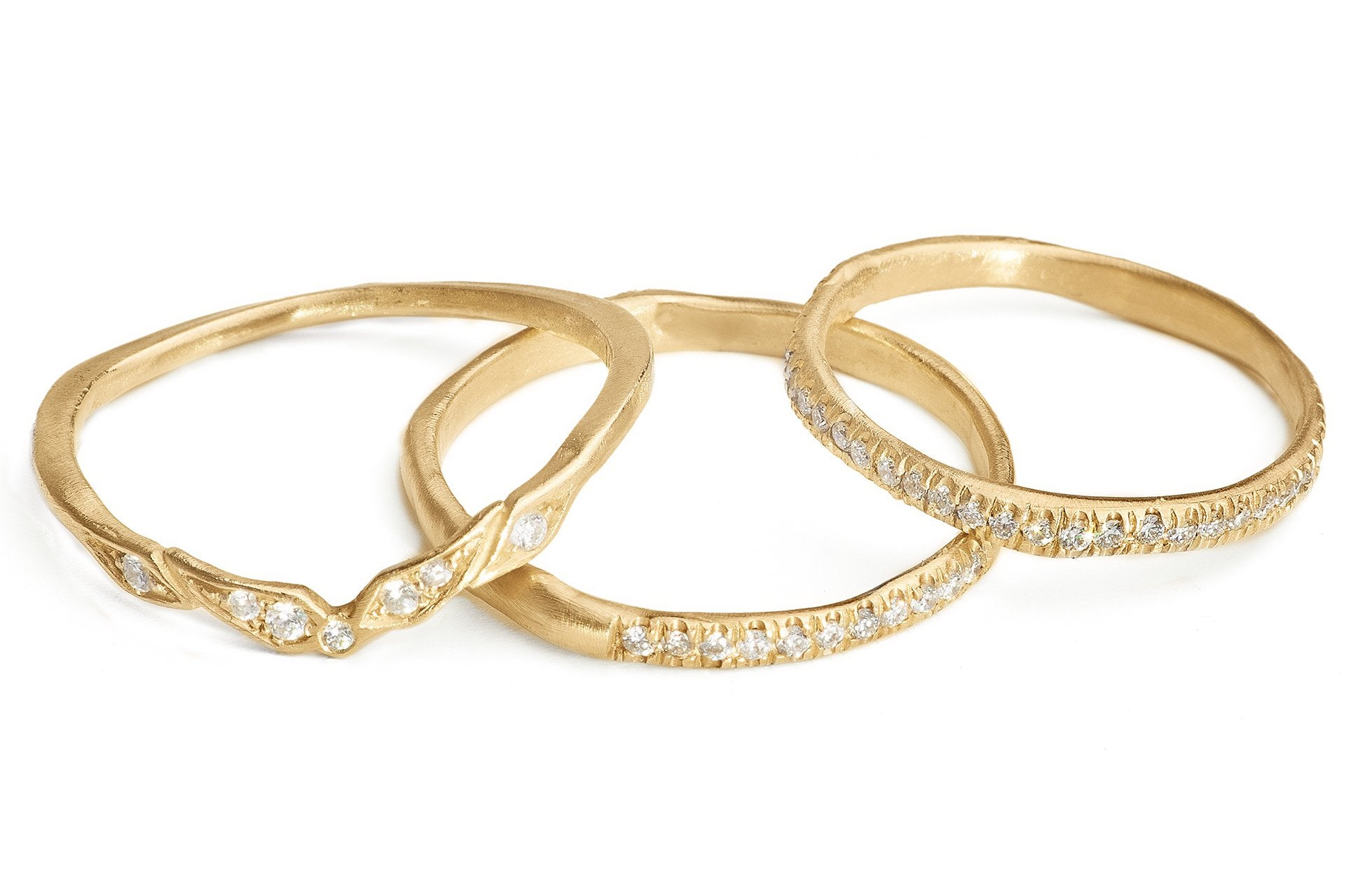 Pave diamond gold stacking rings and wedding bands