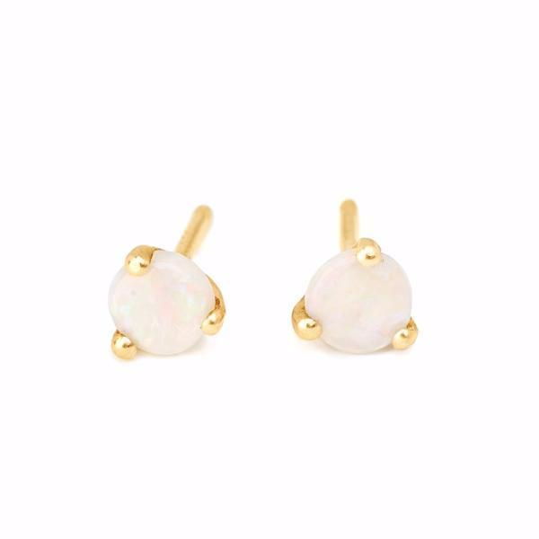 tiny delicate round white opal studs set in 14kt recycled yellow gold