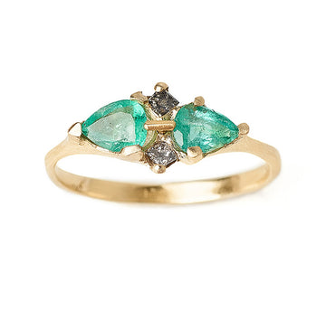 Pale pear shaped emeralds and grey diamond multi-stone engagment ring