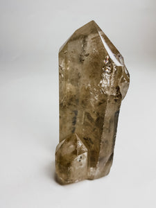 Smoky Quartz Point with inclusions