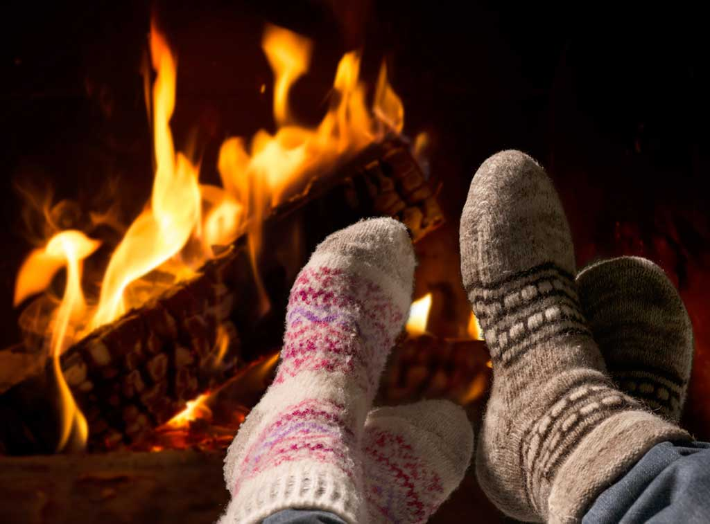 Couple with socks on in front of fire, cold weather, hot sex, ready for bunnyjuice