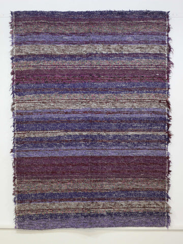 Ibiza handmade rug in shades of purple ideal for small living areas