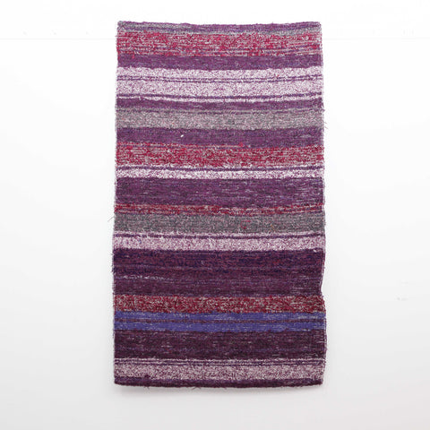 Purple Ibiza handwoven bedside rug also ideal in kitchens