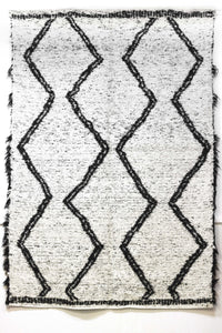 Black & white Berber handmade rug, ideal for large living areas - white side with black pattern