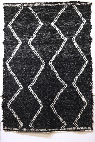 Black & white Berber handmade rug, ideal for large living areas - black side with white pattern