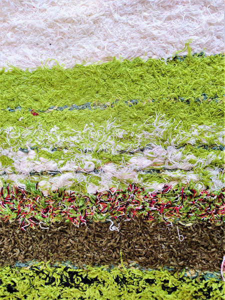 Detail of off-white and green handmade reversible shaggy-like eco large rug