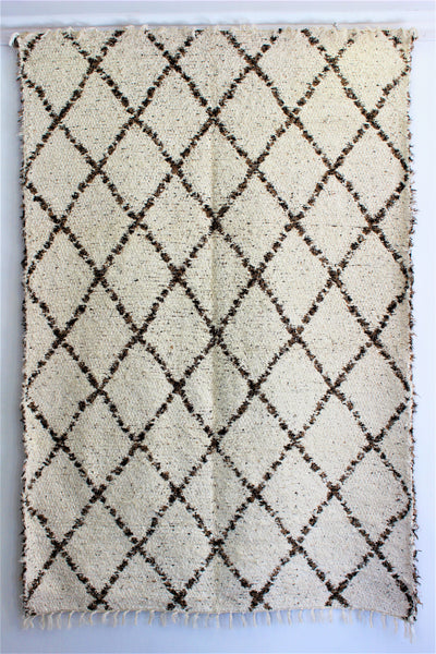 Mottled brown white Berber inspired thick eco rug handmade in Andalucia using recycled cotton - cream side