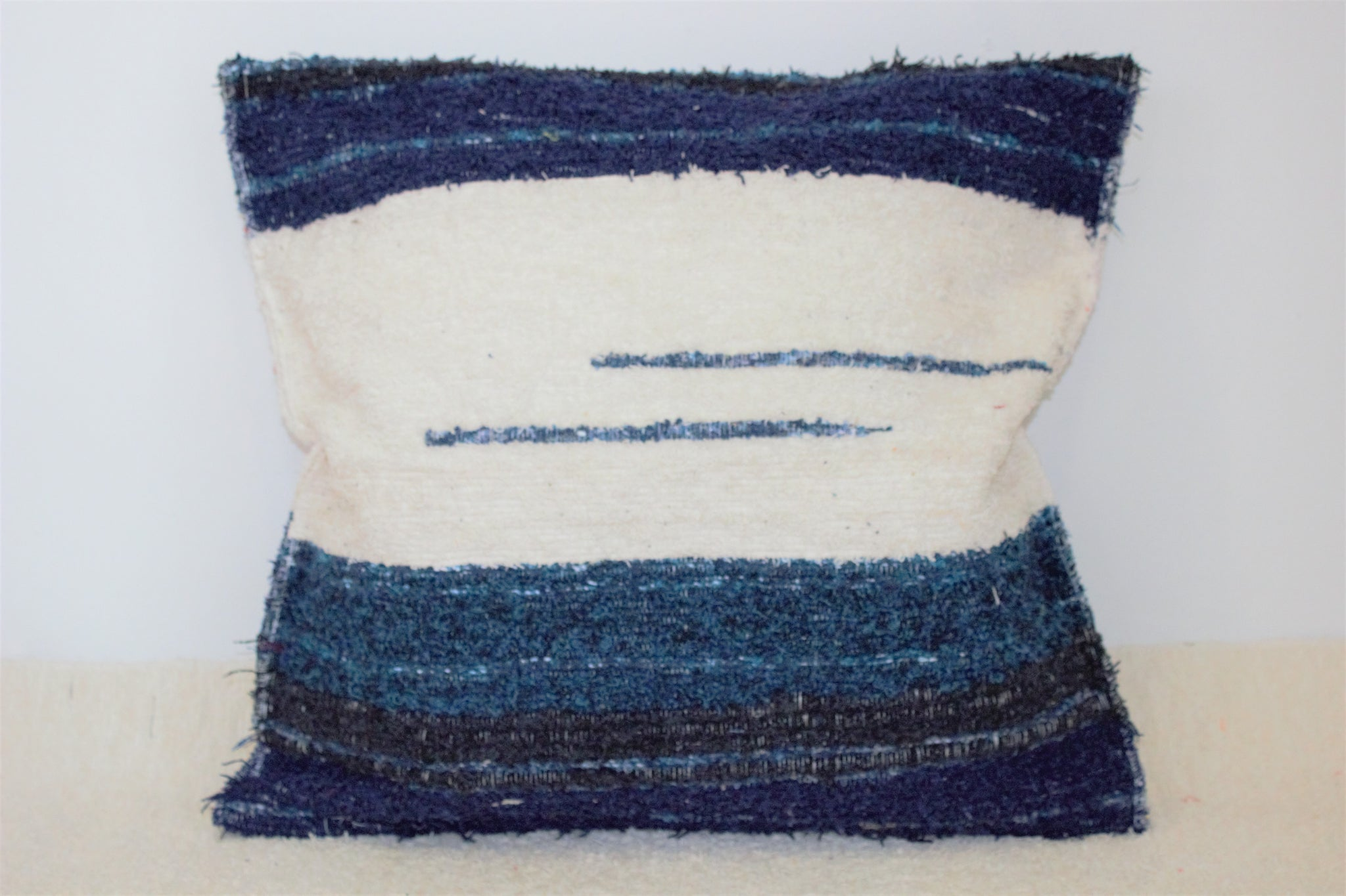 Off-white and dark blue handmade cushion cover
