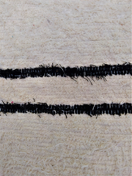 Detail of Nordic handmade floor cushion cover - off-white with black lines
