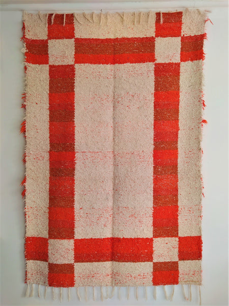 Orange and off-white eco rug handmade in Andalucia with recycled material