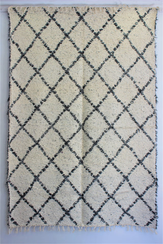 Mottled black white Berber inspired thick eco rug handmade in Andalucia using recycled cotton - Cream side