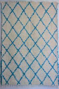 Turquoise Berber inspired thick eco rug handmade in Andalucia using recycled cotton - Cream side