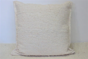 Off-white handmade cushion cover using recycled material