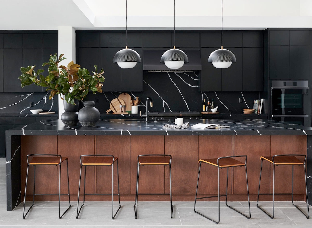 black marble and wood kitchen design