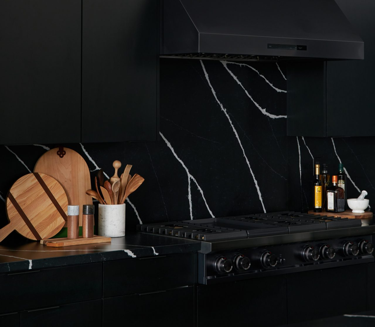 black on black marble kitchen