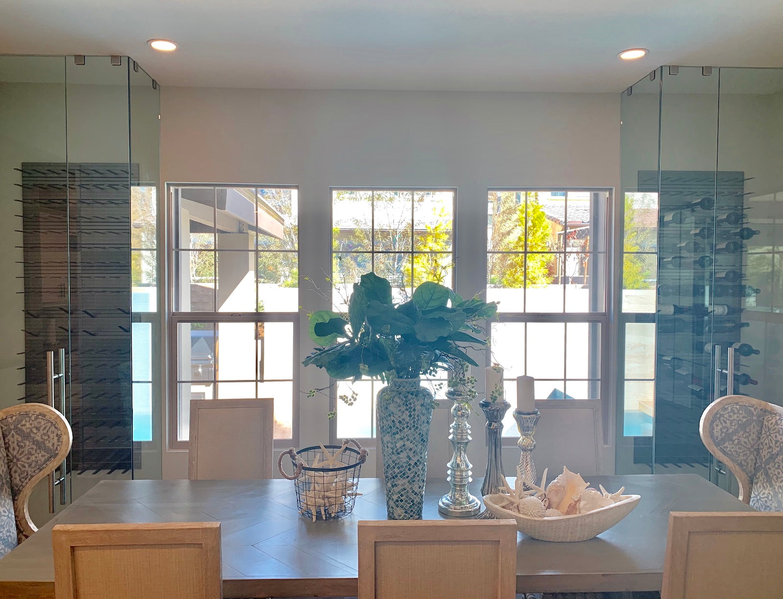 corner glass wine cellars in dining room
