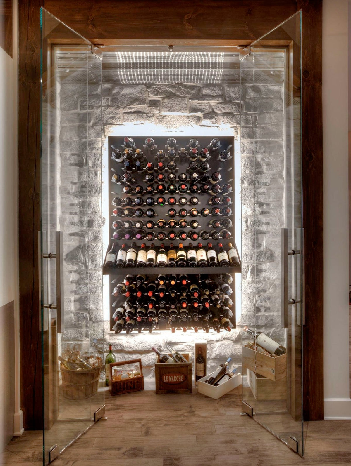 glass enclosed wine cave with stone wall