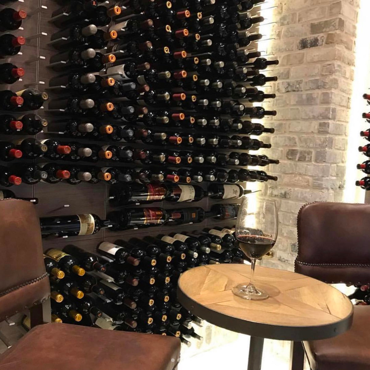 transitional custom wine cellar design with pegged wine storage