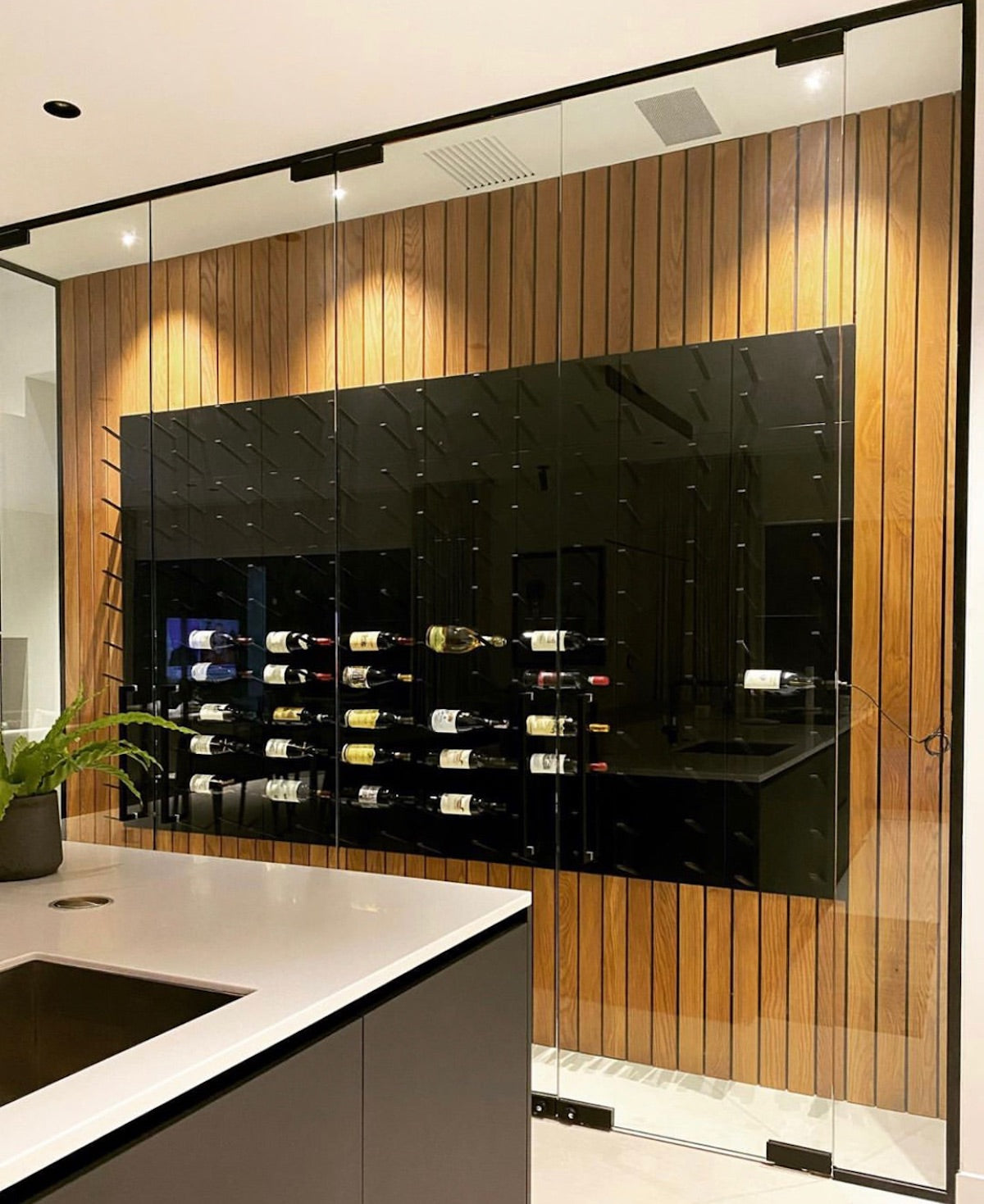 kitchen feature wall wine cellar encased in glass