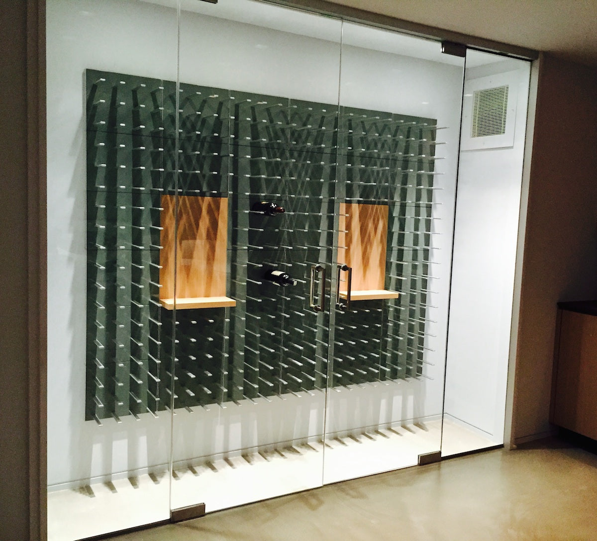grey wine wall inside glass cellar