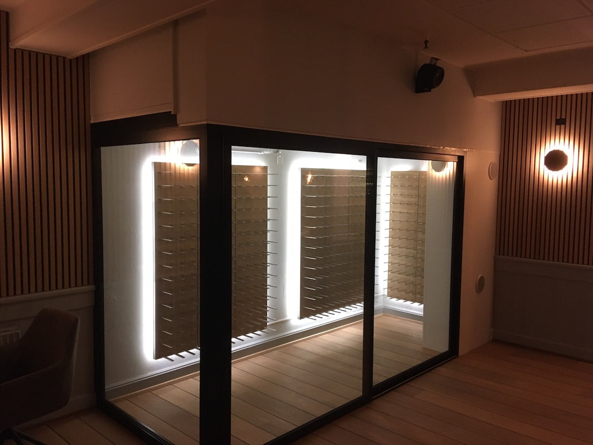 glass enclosed wine room with backlighting