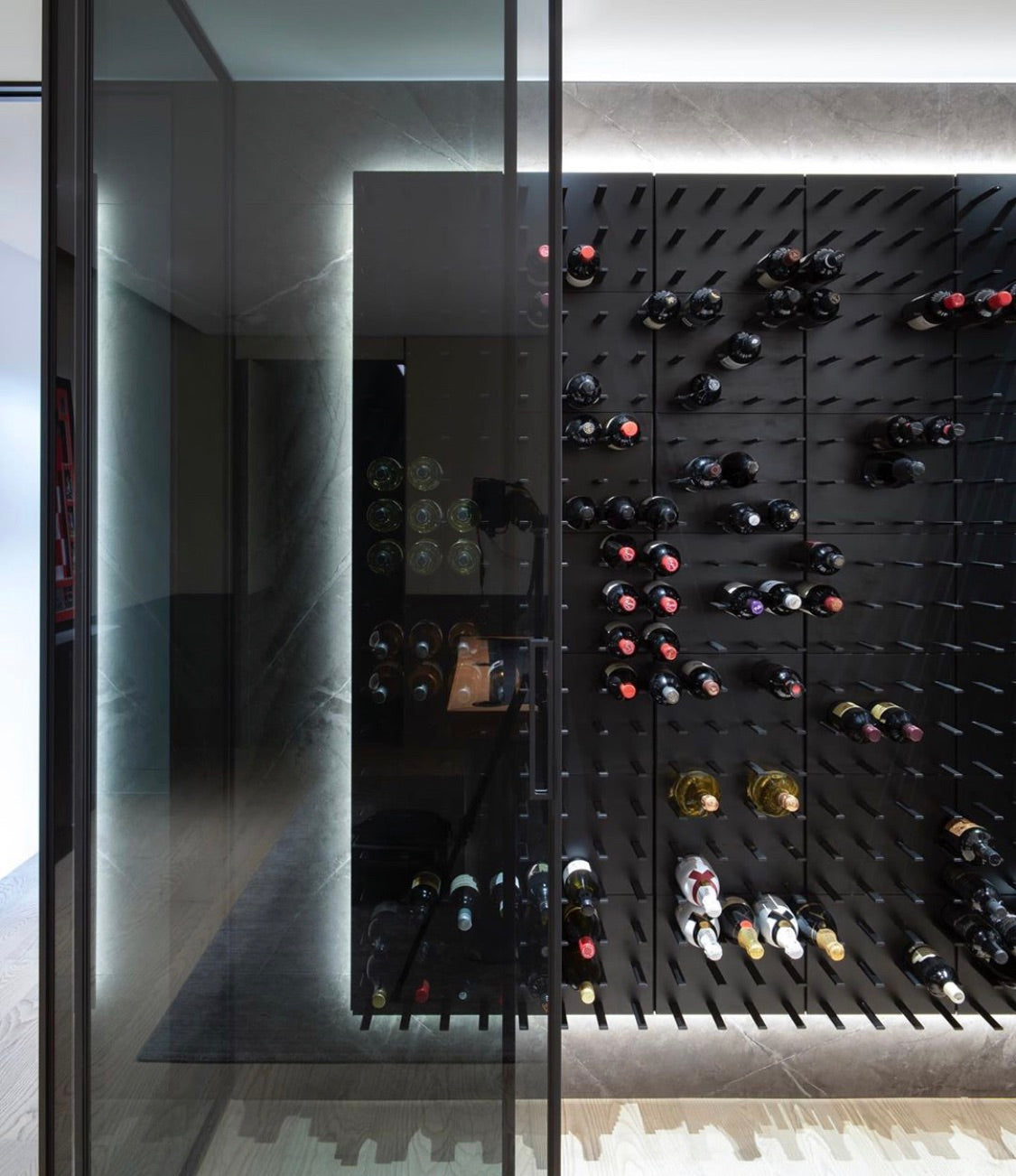 led strip lights installed in glass enclosed wine room