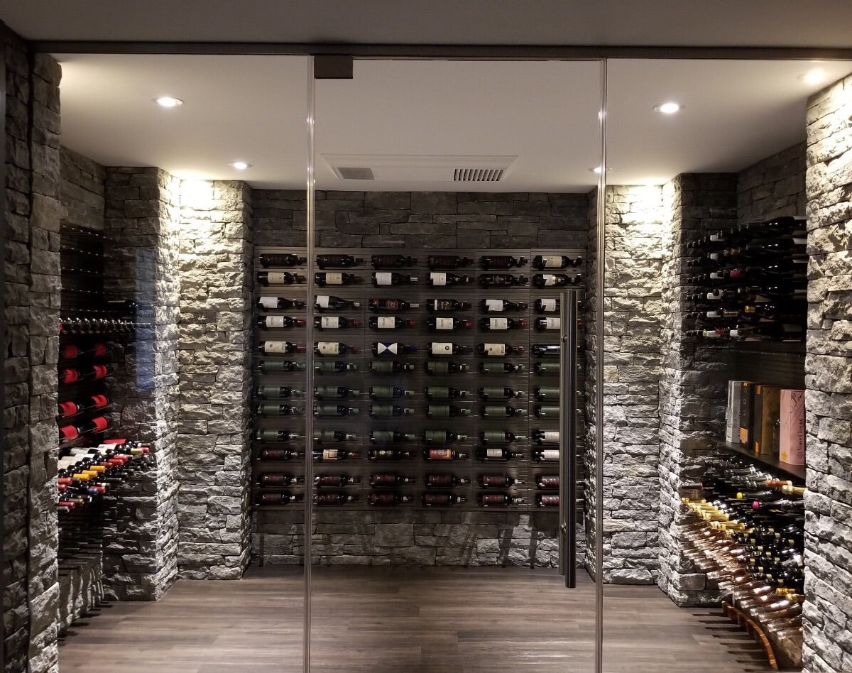 metal wine pegs in glass-enclosed wine room