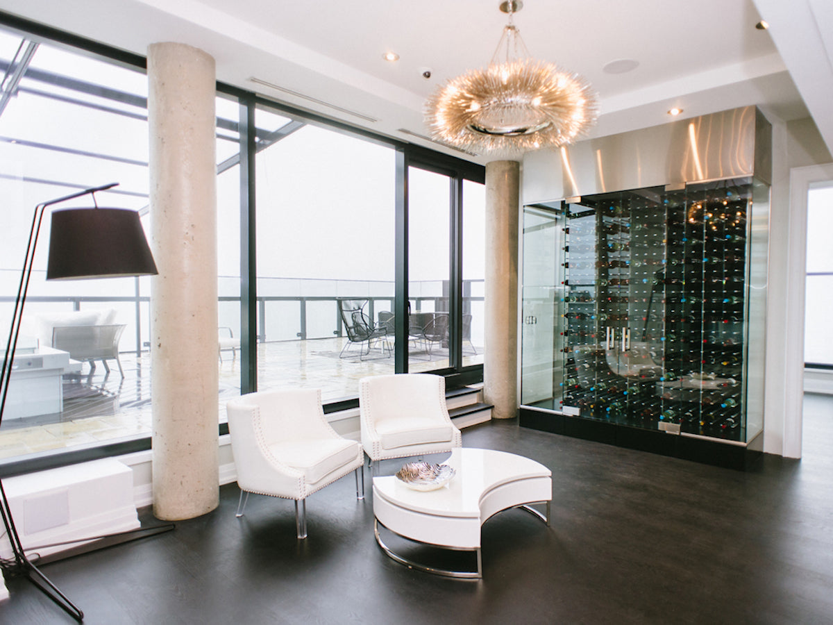 glass encased wine display in luxury penthouse
